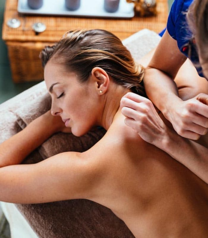 Young woman getting thai massage in spa